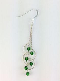 These green long dangle earrings are made with sterling silver and green Swarovski crystals. All metal parts of the earrings are 925 sterling silver, and crystals are finest quality Swarovski elements
