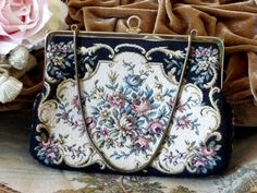 Hey, I found this really awesome Etsy listing at https://www.etsy.com/listing/266834875/vintage-black-cream-tapestry-purse-with