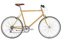 sarı bir bisiklet biraz eskimiş filan ağaçlı bir yol filan ohh