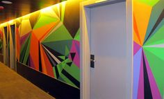 Seven artists were each given one entire corridor to take over in the new Vincci Bit Hotel in Barcelona, which will open in April. Matt W. Moore's 4th floor takeover is a mega mural stretching 50 feet long. Matt spent two weeks (and 14 gallons of paint!) painting the hallway – check out the results
