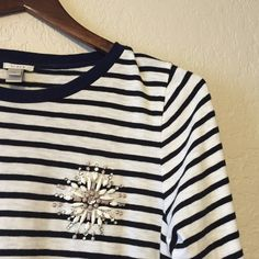 J.Crew Stripe Painter Tee with Jeweled Brooch This is a cotton 3/4 length sleeve top. The stripes are black and white, the collar is navy blue. All beading is in tact. The shirt has been worn minimally and is in like-new condition. This would look fantastic under a blazer or with a quilted vest! J. Crew Tops Tees - Long Sleeve