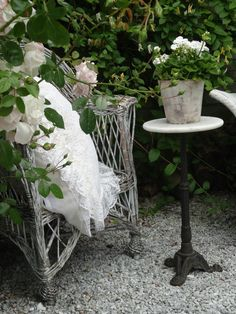 I have a gravel courtyard and an all white garden- I am going to drag some of my white wicker off the porch this summer and stage it just like this when we have people over-so pretty! Moon Garden, Dream Garden, Garden Art, Garden Nook, Outdoor Rooms, Outdoor Gardens, Outdoor Living, Rose Cottage, Shabby Cottage