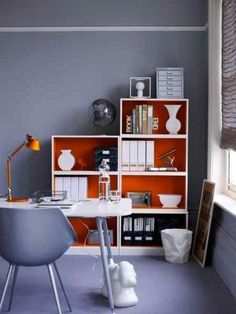 Bright accents within a bookcase. Like the idea.
