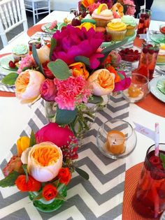 Chevron Stripe table runner and bright flowers add some fiesta ware dishes and you are all set!