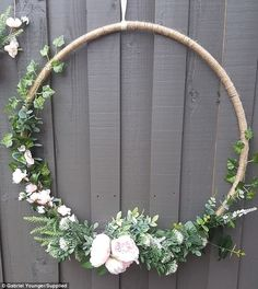 This gorgeous DIY wedding wreaths have been made using a $5 hula hoop from Kmart, twine and a selection of fake flowers and foliage