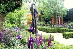 This bronze sculpture, 'Let Heaven Go' was created by Anna Gillespie. The figure symbolises the anguish and despair experienced by residents of multi-storey housing who have lost their gardens or don't have access to green outdoor space and the beauty of nature.