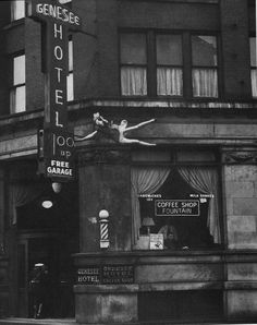 """The Genesee Hotel jumper, """"I snatched my camera from the car and took two quick shots as she seemed to hesitate. As quickly as possible I shoved the exposed film into the case and reached for a fresh holder. I no sooner had pulled the slide out and got set for another shot than she waved to the crowd below and pushed herself into space. I took a firm grip on myself, waited until the woman passed the second or third story, and then shot."""" Sorgi 1942"""