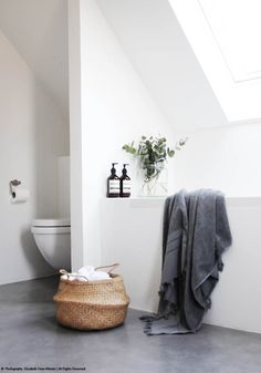 Design Files BODIE and FOU A stunning bathroom with concrete floor, natural basket from www.bodieandfou.com