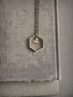 love geometric shapes and cute bees! tiny bee necklace by bellehibou on Etsy, $26.00 @Caitlin Kincaid
