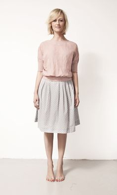pink blouse + grey skirt with white dots