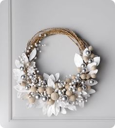 grapevine wreath, felt leaves, yarn wrapped balls, silver balls, white and glittered silver berries, silver jingle bells