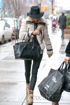 Sienna Miller.. Fall chic.. with Isabel Marant Nowles Boots, and Prada Canapa and Saffiano Leather Tote..