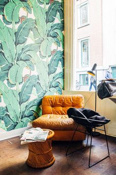 Take inspiration from this beautiful lounge and living room that features a glorious display of plant wallpaper featuring green leaves and flowers that can be used in home design for a splash of green or a botanical accent. Use plants in your home interior design!