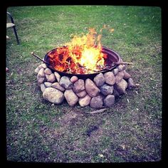 My DIY firepit.  Made from a tractor tire rim and stacked rocks.