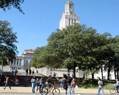 Students walk and ride to class on Speedway below the Tower - The University of Texas at Austin