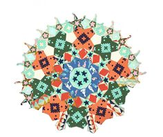 La Passacaglia Quilt Rosette made by Alexandra Luenz using Cotton+Steel fabric.