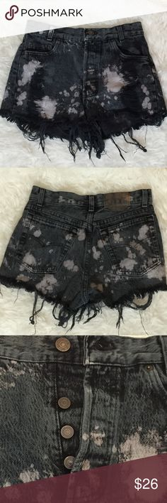 VTG Levi Jeans Distressed Bleached Denim Shorts XS Awesome pair of very heavily distressed, authentic, true vintage Levi's Jeans. Ripped, Bleached, Shredded these shorts have been put through the ringer and are so much more cool because of it. Basically black denim with white bleach effect, these are truly a work of art. I'm calling these an XS (they don't fit my usually small self), but they're missing a size tag so please take a look at the pictures showing the measuring tape. Flaw to note…