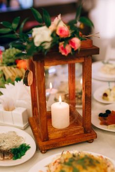 Beautiful rustic wooden lantern, decorted with flowers a little bit, to make your wedding warm and cozy