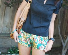 Tropical Silk Running Shorts and Black Dotted Blouse Outfit