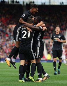 Romelu Lukaku of Manchester United celebrates with his team mates after scoring a goal to make it 12 during the Premier League match between Stoke...