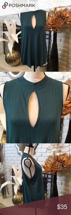 Free People green sleeveless top w/mock collar! Super soft easy going breezy top!  Has a peek a boo opening at the front.  Mock turtle neck style.  Fabric has striping detail throughout.  Slightly high low cut.  Never been worn new with tags! Free People Tops
