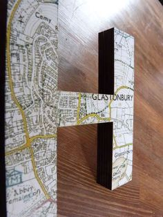 Map Letters - don't pay the price Urban Outfitters is charging.  Can get letter templates at Michael's or Hobby Lobby, then Mod-Podge old maps onto them.  #DIY #craft