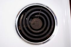 How to clean the burner bowls on your stove with boiling water and baking soda.  I'm trying this!