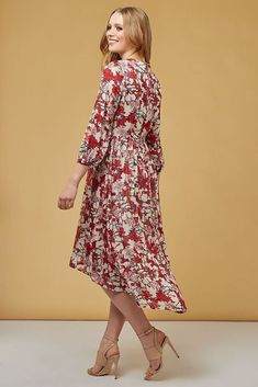 d526affb27c9 Veronique Floral midi dress to see you through the season. The Louche  Veronique Spider Lilly