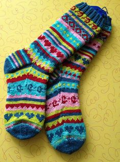 This is a monster sock pattern to use up remnants of sock yarn left over from other projects. Pattern is largely written with small sections of charted colorwork. Socks are a standard 64 (72) stitch pattern.