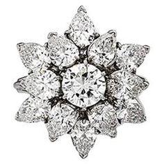 Platinum brilliant cut and pear shaped diamond ring