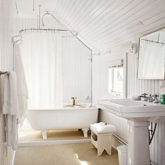 Freshen Up With Rooms That Are Bright and White   Bathroom   CoastalLiving.com  Kids?  Love the tub & shower set up!