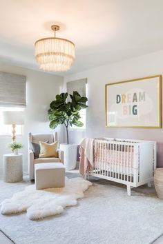 """A girl's nursery by Pure Salt Interiors. Cozy and pink with glamorous lighting and """"Dream Big"""" artwork."""