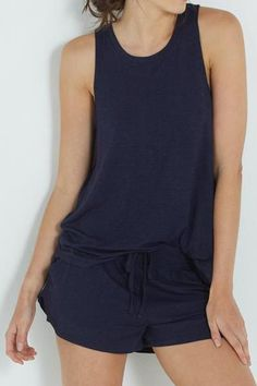 Premium Sleep Tank and Premium Sleep Short colour  MIDNIGHT MARLE Made from super soft bamboo viscose fabric & with moisture wicking technology, to keep you comfortable & relaxed all night long. Standard length body Comfortable relaxed fit Rounded neckline Specked marle fabric effects Jersey knit fabric Short shorts, to show off those legs Fabric waist tie Elasticated waistband Hip pockets Jersey knit fabric 95% BAMBOO VISCOSE 5% ELASTANE Product code: 664110-01 and 664098-02