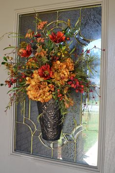 Fall Decor - Flower arrangement hung on the outside of the front door. Fall Floral Arrangements, Autumn Decorating, Autumn Wreaths, Fall Flowers, Wreaths For Front Door, Tablescapes, Thanksgiving, Harvest, Holidays