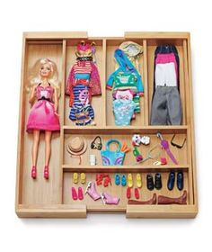 Expandable drawer organizers are intended for kitchen or office supplies, but a few of them in a kid's room can keep small toy pieces from taking over. They're adaptable to fit nearly any size drawer.