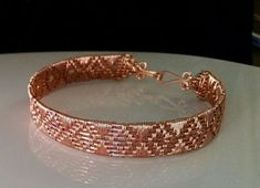 This Diamond Weave Copper Bracelet Tutorial includes 13 pages of step-by-step instructions as well as numerous clear, close-up photos. It has