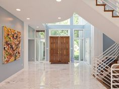 Contemporary Entryway with French doors, Transom window