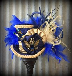 Mini Top Hat Blue and Gold Eagle Hat Alice in by ChikiBird on Etsy Steampunk Couture, Gothic Steampunk, Victorian Gothic, Gothic Lolita, Mad Hatter Hats, Mad Hatter Tea, Harry Potter Hat, Alice In Wonderland Hat, Steampunk Clothing