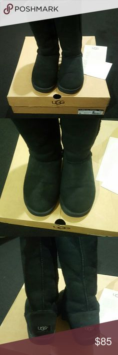 UGG Classic Tall AUTHENTIC Black Uggs. Used, but in GREAT condition. Also bought new genuine UGG sheepskin insoles to keep the boot feeling fresh, soft & cushioned. Treated with stain repellant professionally already & had the new insoles inserted, as shown in picture. No stains and clean! Comes with original box & packaging. Offers welcomed. UGG Shoes