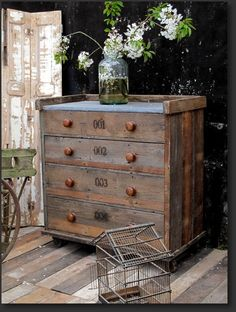 zinc top chest {this website has tons of cool rustic furniture}