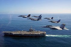 U.S. Naval aircraft and aircraft from the Chilean Air Force participate in a fly-by adjacent to aircraft carrier USS George Washington (CVN 73).