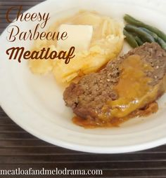 meatloaf topped with cheddar cheese and barbecue sauce