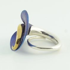 A handcrafted and stunning blue calla lily ring in sterling silver and titanium and a 24ct gold plating.  $384 http://www.crowdedsilver.com.au/store/rings-c-358.html #SilverRing #SilverJewellery