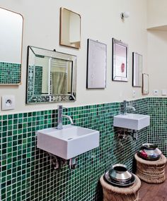 Bohemian bathroom with green mosaic tile and a wall full of mirrors... lovely!   The Paris apartment of Stephanie de Saint Simon, owner of Ouma Productions.