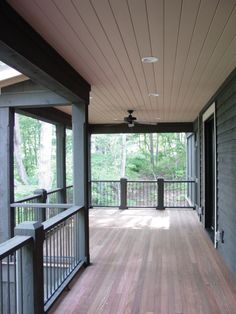 A back porch is a Southern staple. Especially when you have a view of Lake Keowee. LOVE the pretty wood floors used for this home!