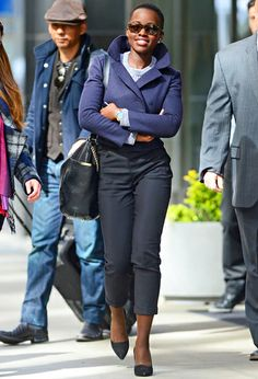 Lupita Nyong'o looks chic in NYC on Monday, Apr. 28, wearing a navy cropped coat and black pants