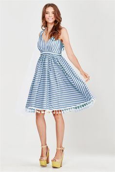 Muted vintage tones of blue or yellow are striped across this 50's style cut dress. It has self-tying straps that are ruched and adjustable at the back through oversized eyelets. The cups have generous pleats and are gathered underneath with a beige plaited trim. Underneath the bust the gathered seams come out to a full skirt that is finished with tassels on the hem. Summer 2017 Size & Fit: Model is 177cm tall Model wears a NZ 8/ NZ S/ EU 36/ US 4 Wash Guide: Cool hand wash or gentle machine