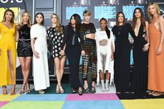 As televisions across the country switched to MTV for Sunday night's Video Music Awards, one of the first things viewers likely saw was a group of 10 statuesque beautiestowering a foot above the r…