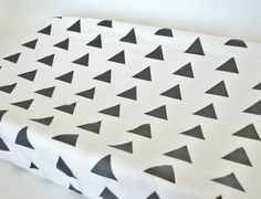 **All covers are hemmed to have a professional finish**    This listing is for a black triangle changing pad cover. This fabric is designed by ModFox and