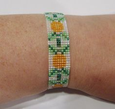 handmade orange flower pattern beaded bracelet #Handmade #Beaded